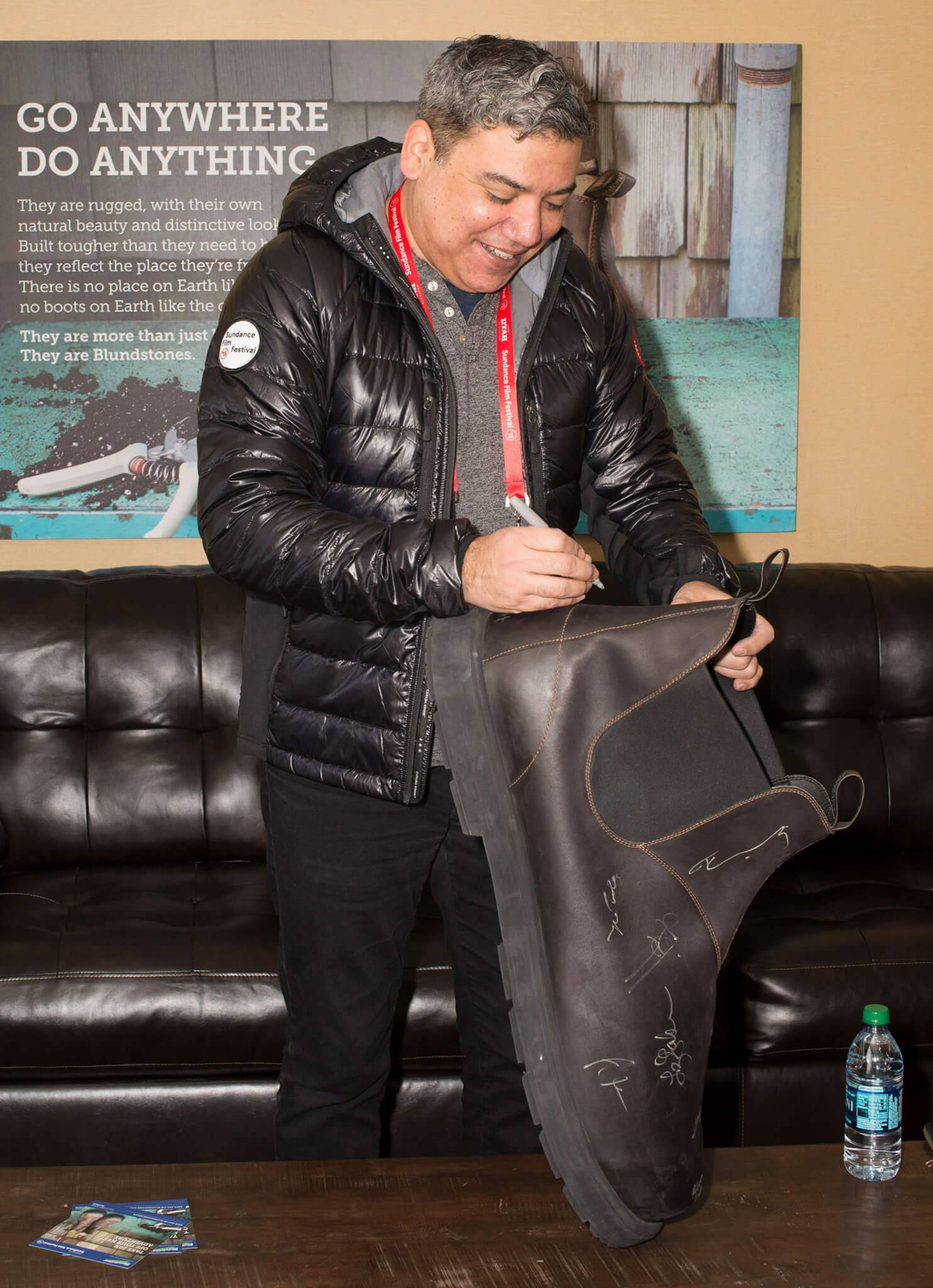 Eugene Hernandez, Deputy Director at Film Society of Lincoln Center, signs a giant Blundstone boot at Sundance 2015.