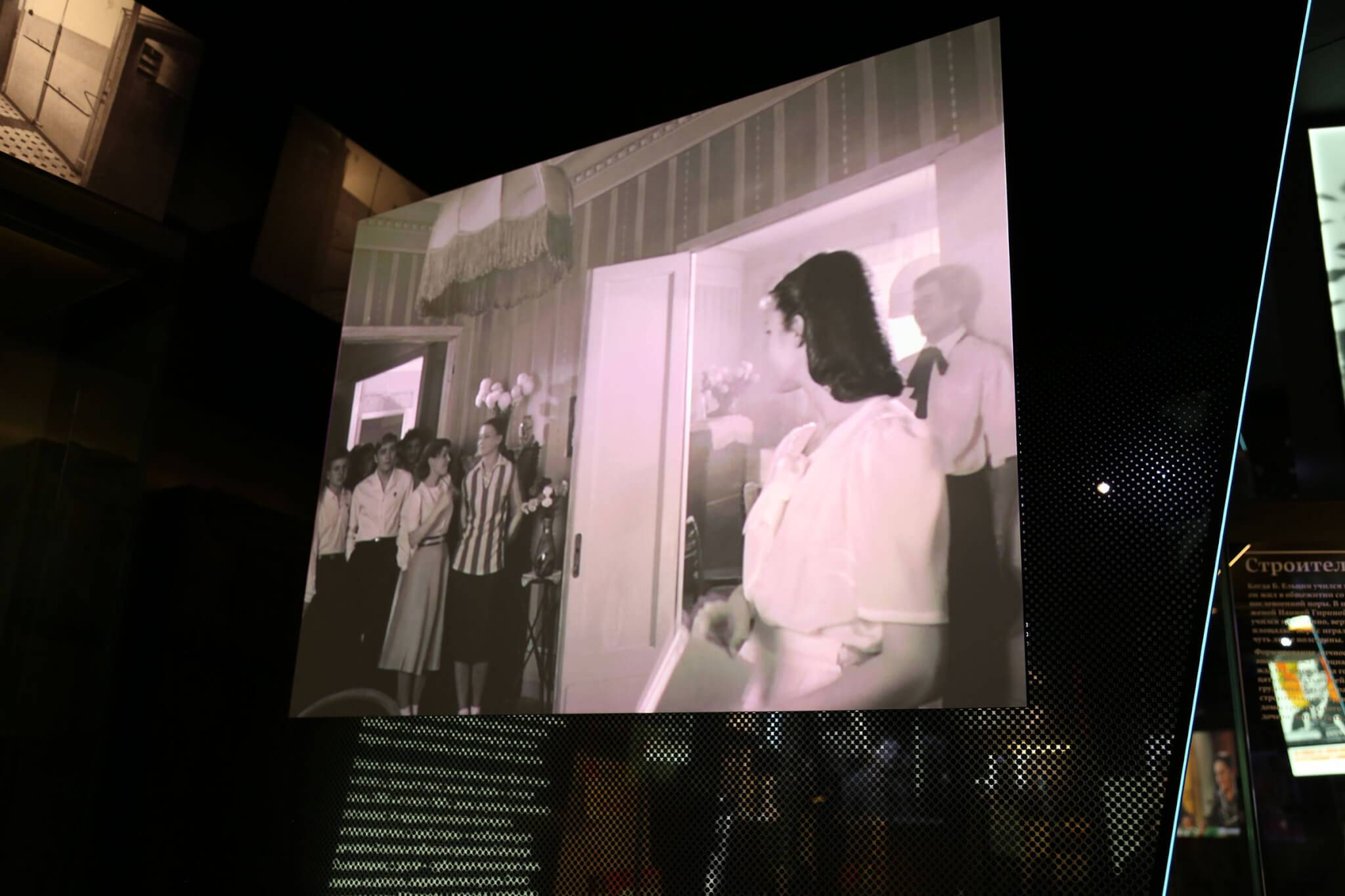 Each montage is projected onto a glass wall that separates the chapters but propels the visitor to the next section.